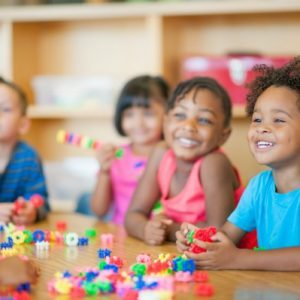 A diverse group of preschoolers in a classroom